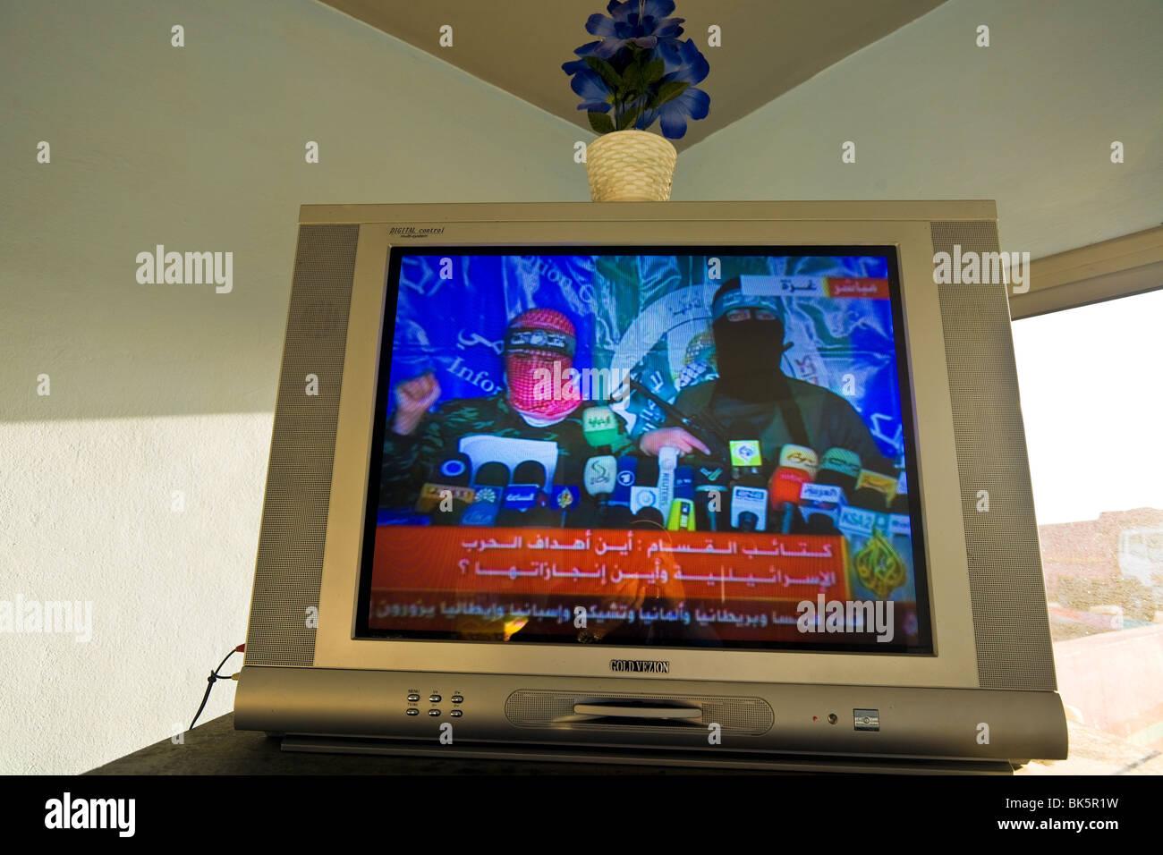 Western Sahara, petrol station, jihadists on television. - Stock Image