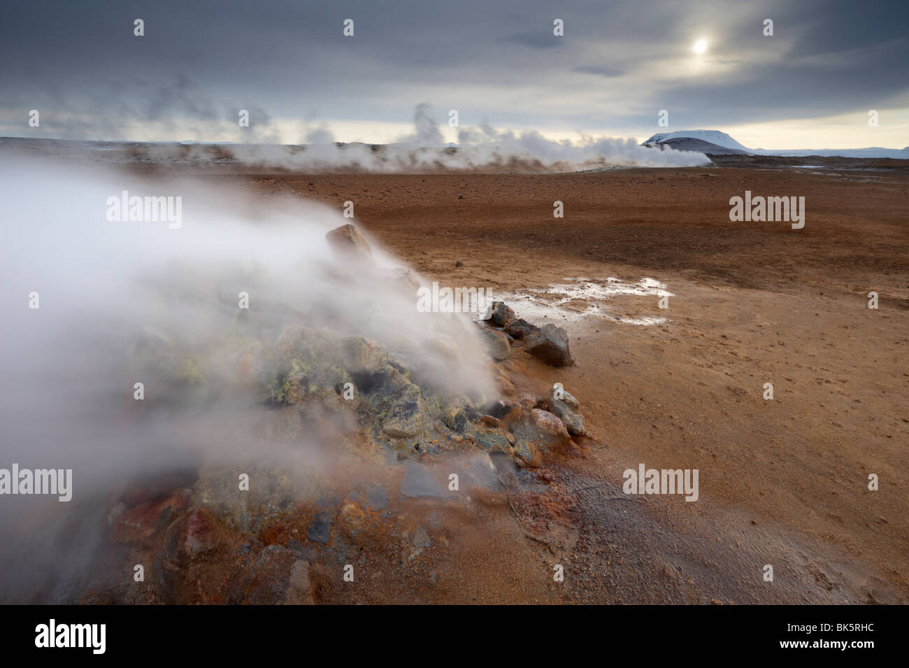 Steam vent at Namaskard geothermal area, Mount Burfell, 935m, behind, near Lake Myvatn and Reykjahlid, Iceland - Stock Image