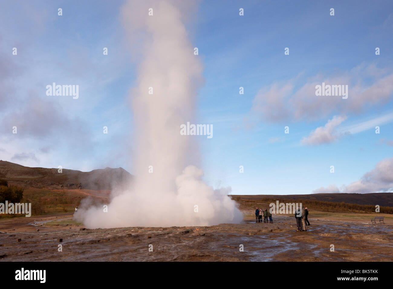 Strokkur (the Churn) erupts every 5-10 minutes to heights of up to 20 meters (70ft), Geysir, Golden Circle, Iceland - Stock Image