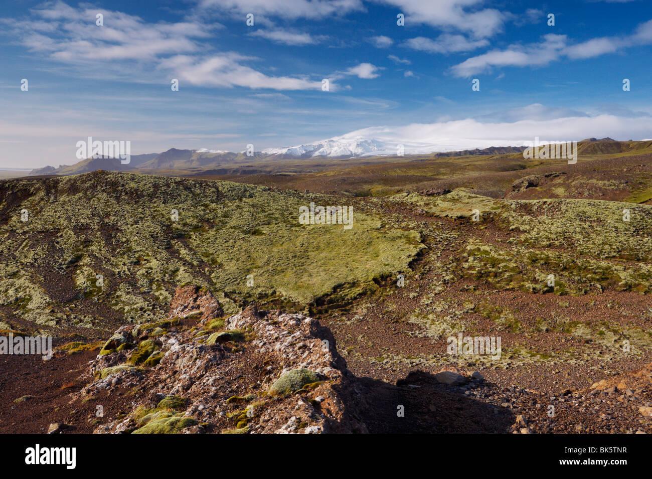 Lava fields, Myrdalsjokull glacier in the distance, near Vik, South Iceland, Iceland, Polar Regions - Stock Image