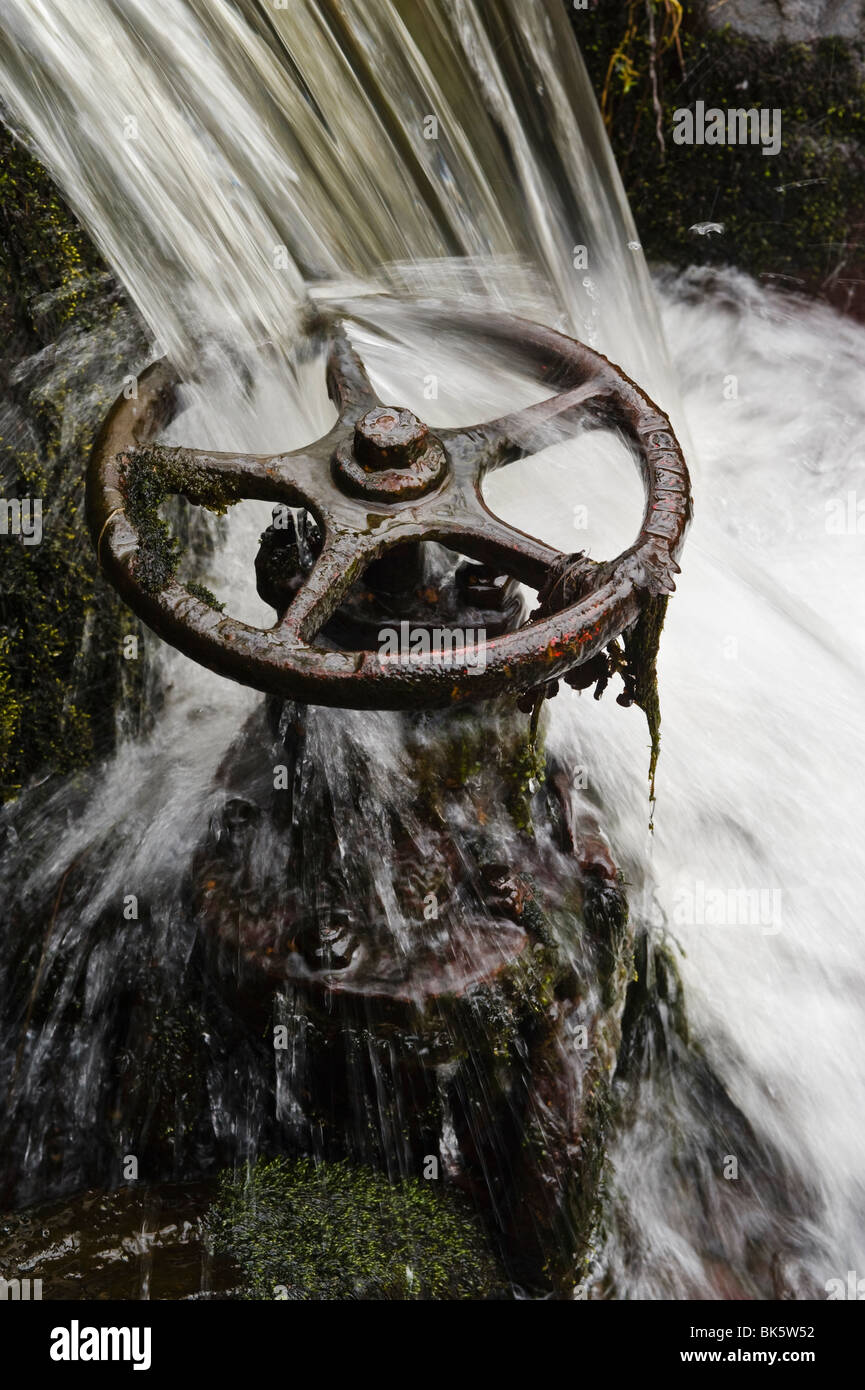 Waterfall and old sluice valve - Stock Image