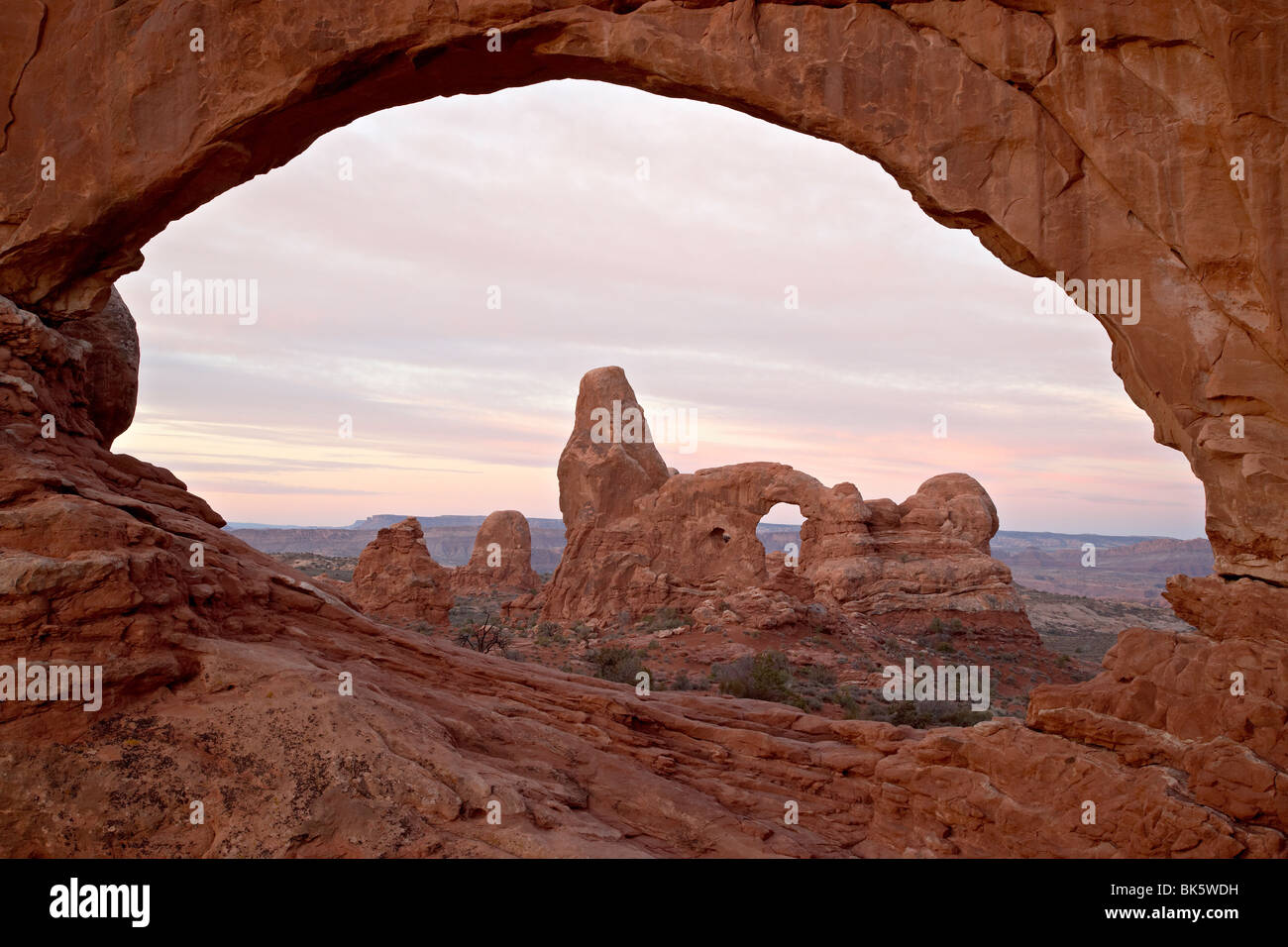 Turret Arch through North Window at dawn, Arches National Park, Utah, United States of America, North America - Stock Image