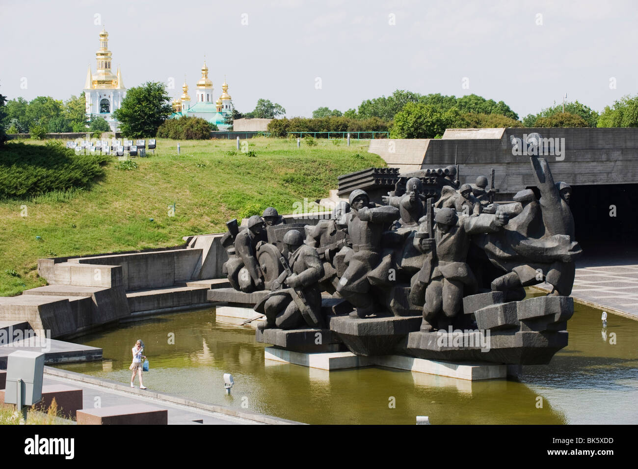Memorial statue at the Museum of the Great Patriotic War,  The Lavra church behind, Kiev, Ukraine, Europe - Stock Image