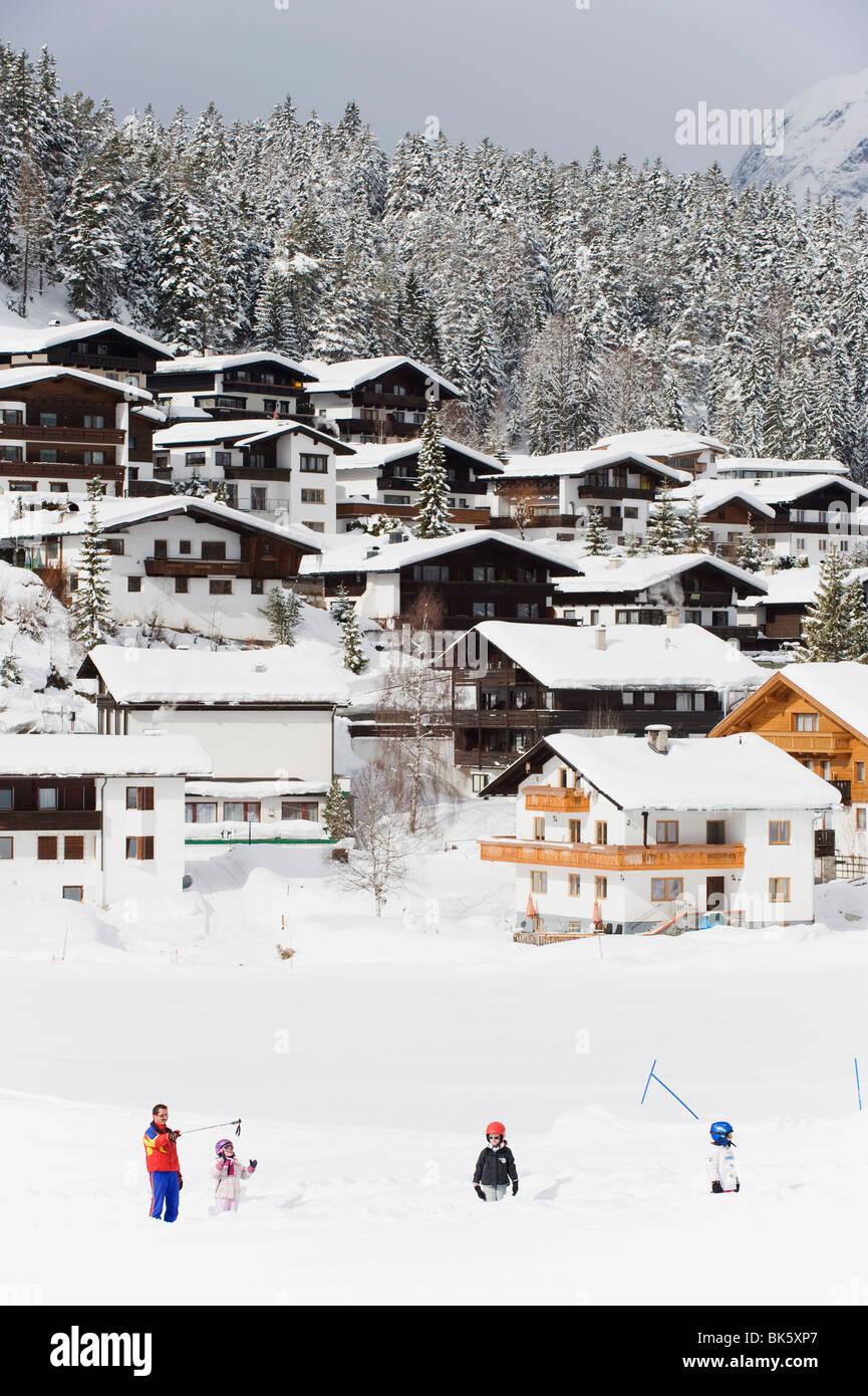 Children on a drag lift at kindergarten ski school, Seefeld ski resort, The Tyrol, Austria, Europe - Stock Image