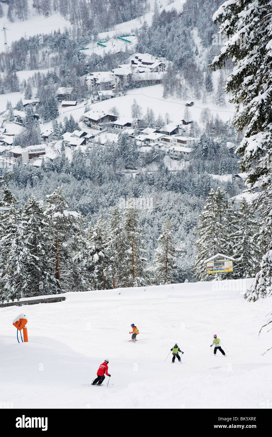 Skiers on piste above Seefeld village, Seefeld, the Tyrol, Austria, Europe - Stock Image