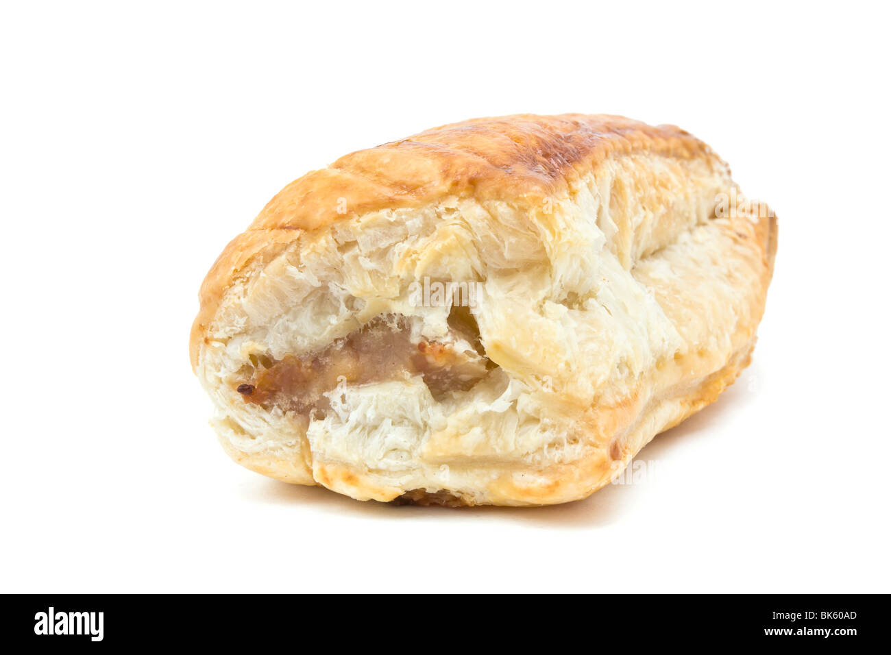 Golden Sausage Roll made from sausage meat and flaky puff pastry. - Stock Image