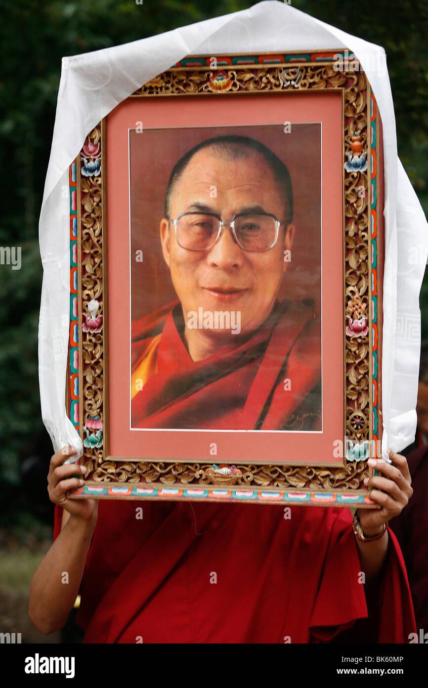 Buddhist holding a picture of the Dalai Lama, Paris, Ile de France, France, Europe - Stock Image