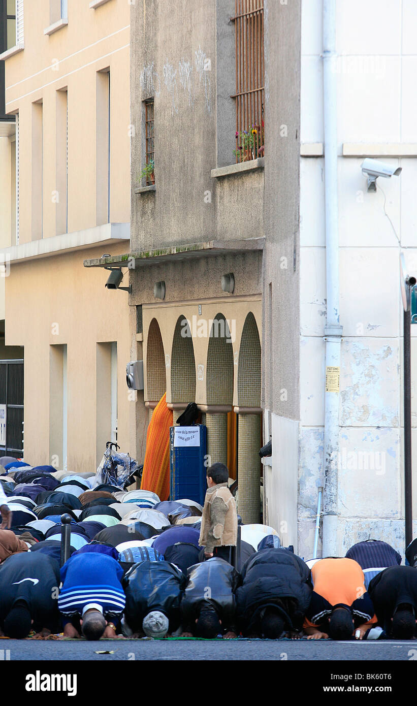 End of Ramadan prayers outside a mosque, Paris, France, Europe - Stock Image