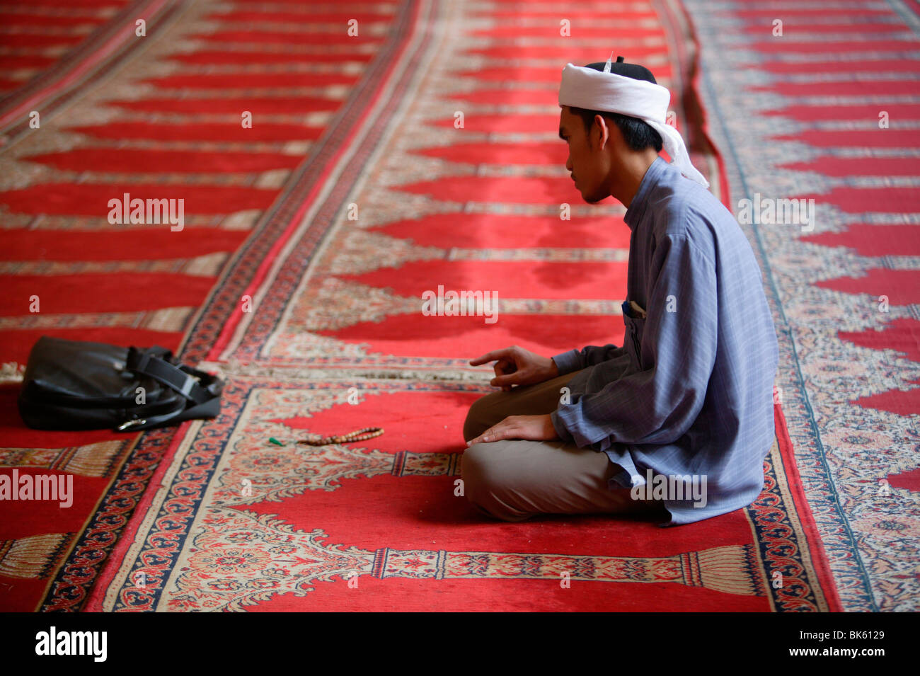 Indonesian visitor at Sultan Hassan mosque, Cairo, Egypt, North Africa, Africa Stock Photo