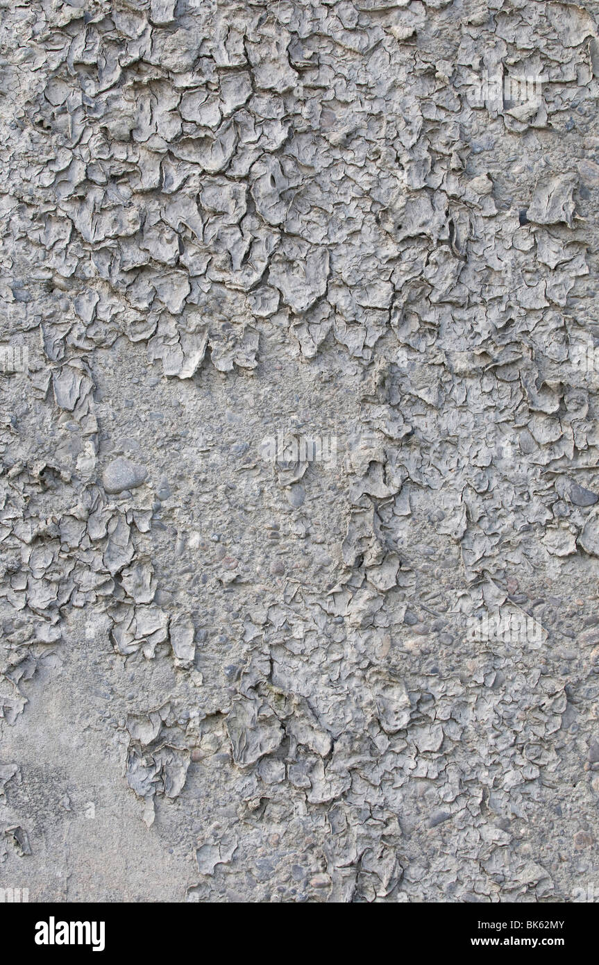Dry cracked mud, background - Stock Image