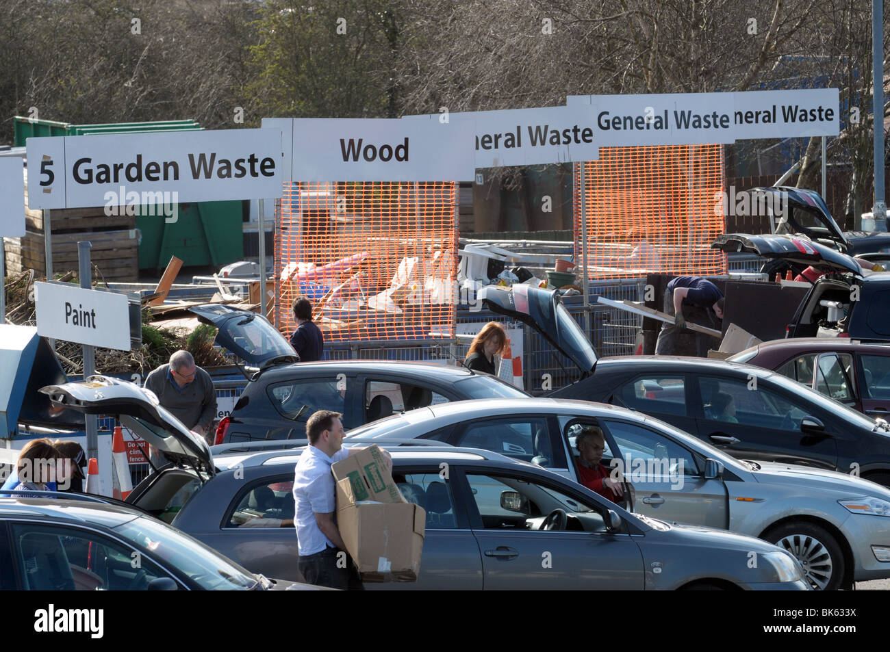 People dumping rubbish and waste at council recycling centre - Stock Image