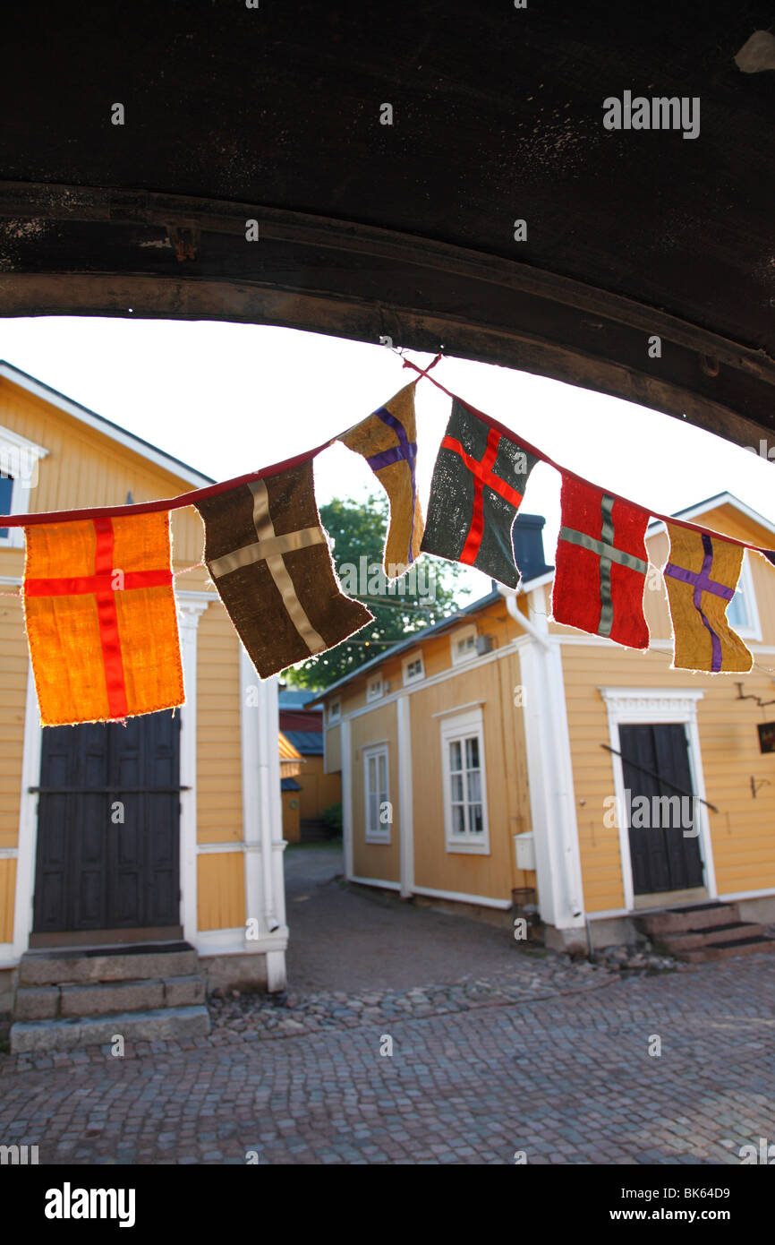 Decorative flags and medieval wooden houses, Porvoo, Uusimaa, Finland, Scandinavia, Europe - Stock Image