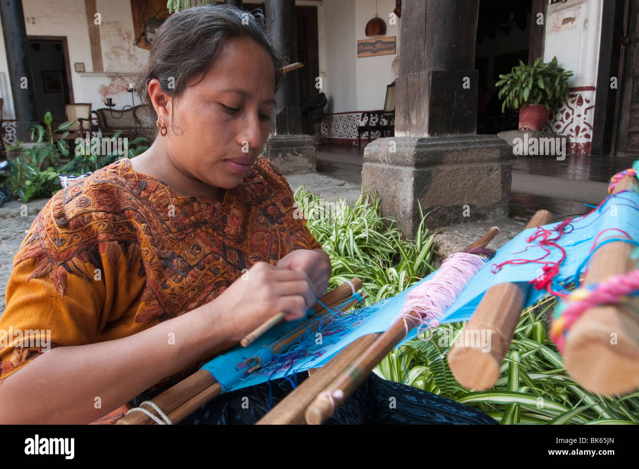 Woman weaving cloth, Antigua, Guatemala, Central America - Stock Image