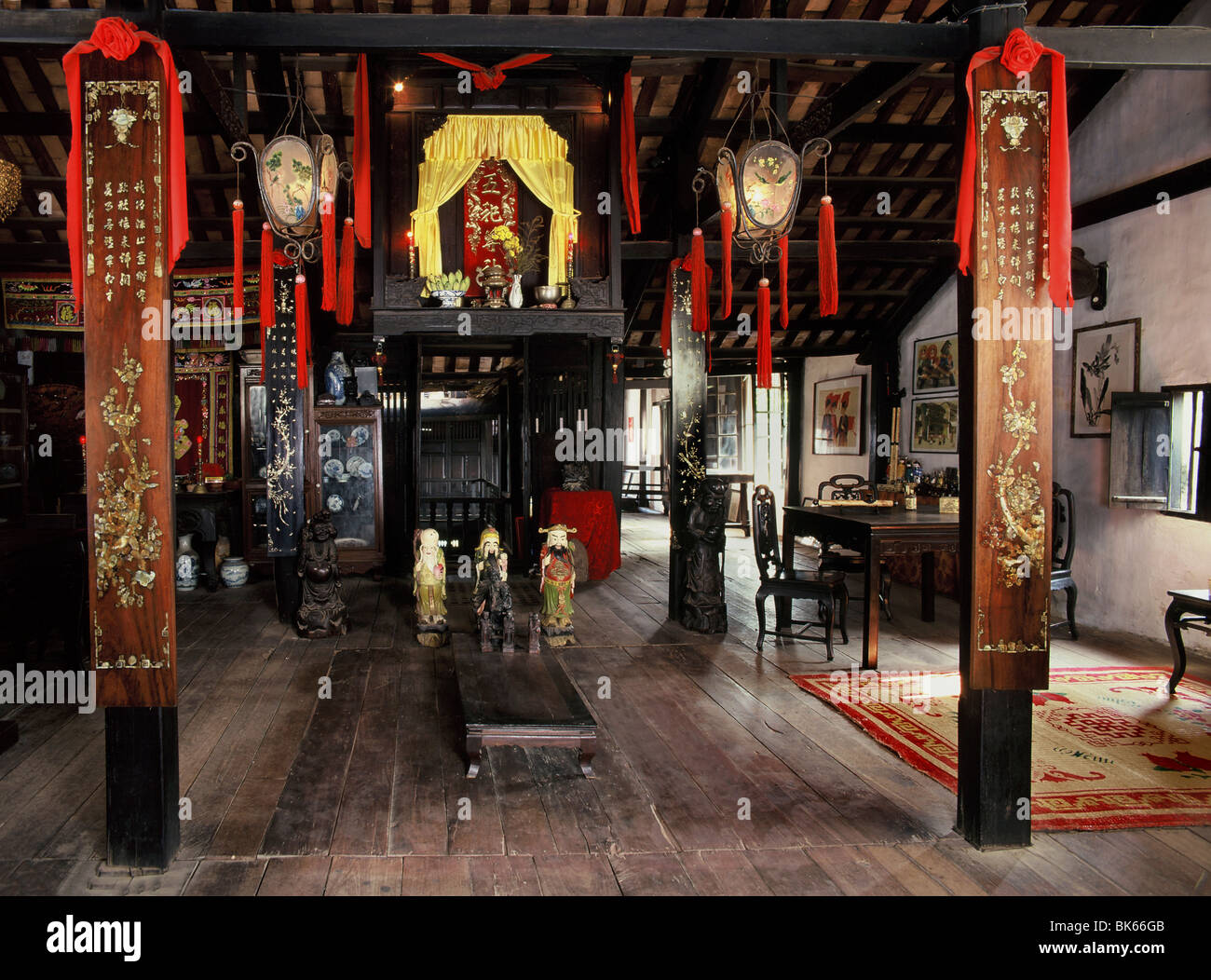 Upper floor with altars in the 18th century Phung Hung House, one of the oldest houses of Chinese traders in Hoi - Stock Image
