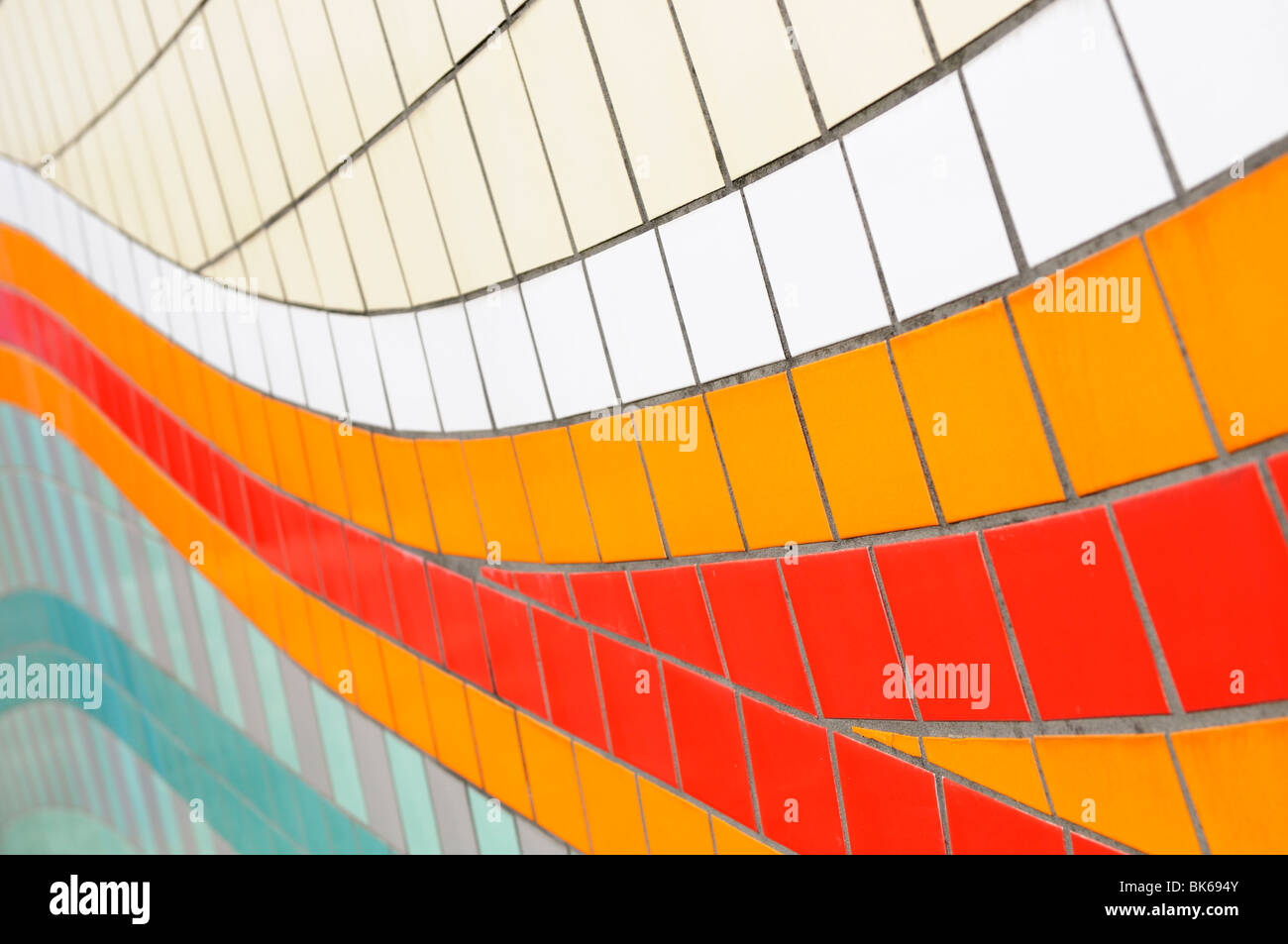 Stock photo of a geometric pattern of brightly coloured exterior wall tiles. - Stock Image