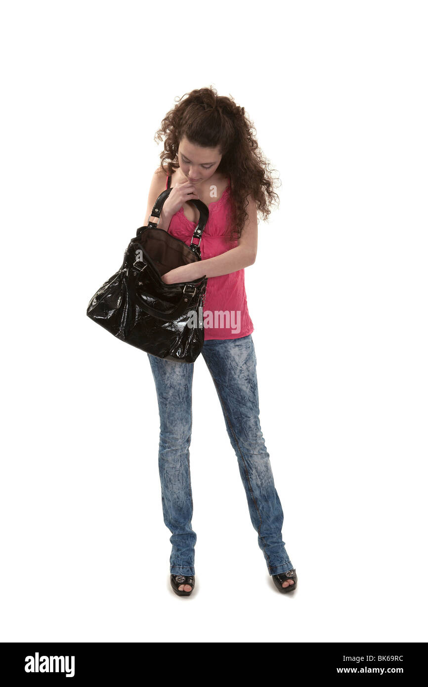 Girl with the big black bag on a white background - Stock Image