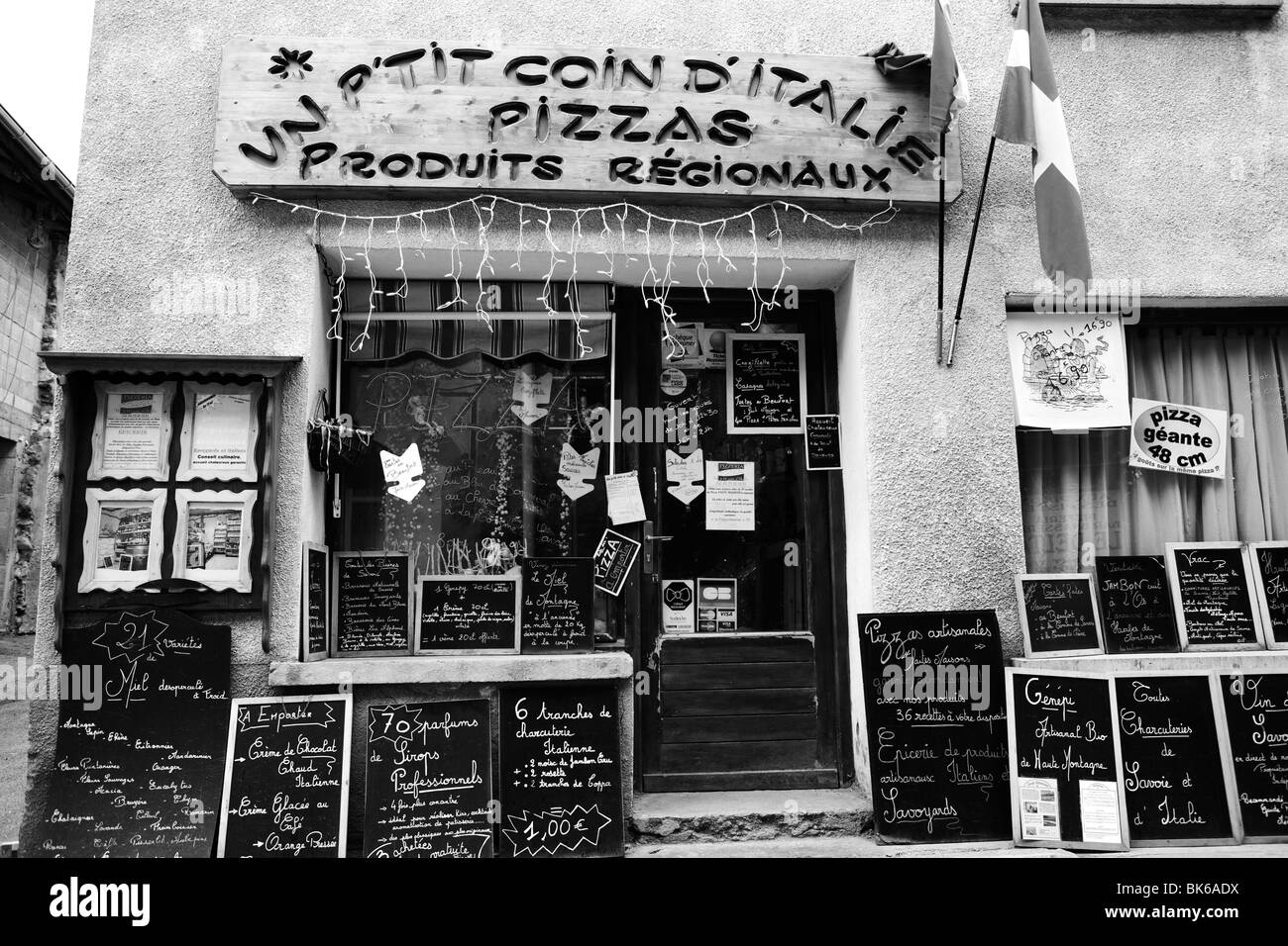 Black and white traditional italian deli in the french ski resort village of aussois stock