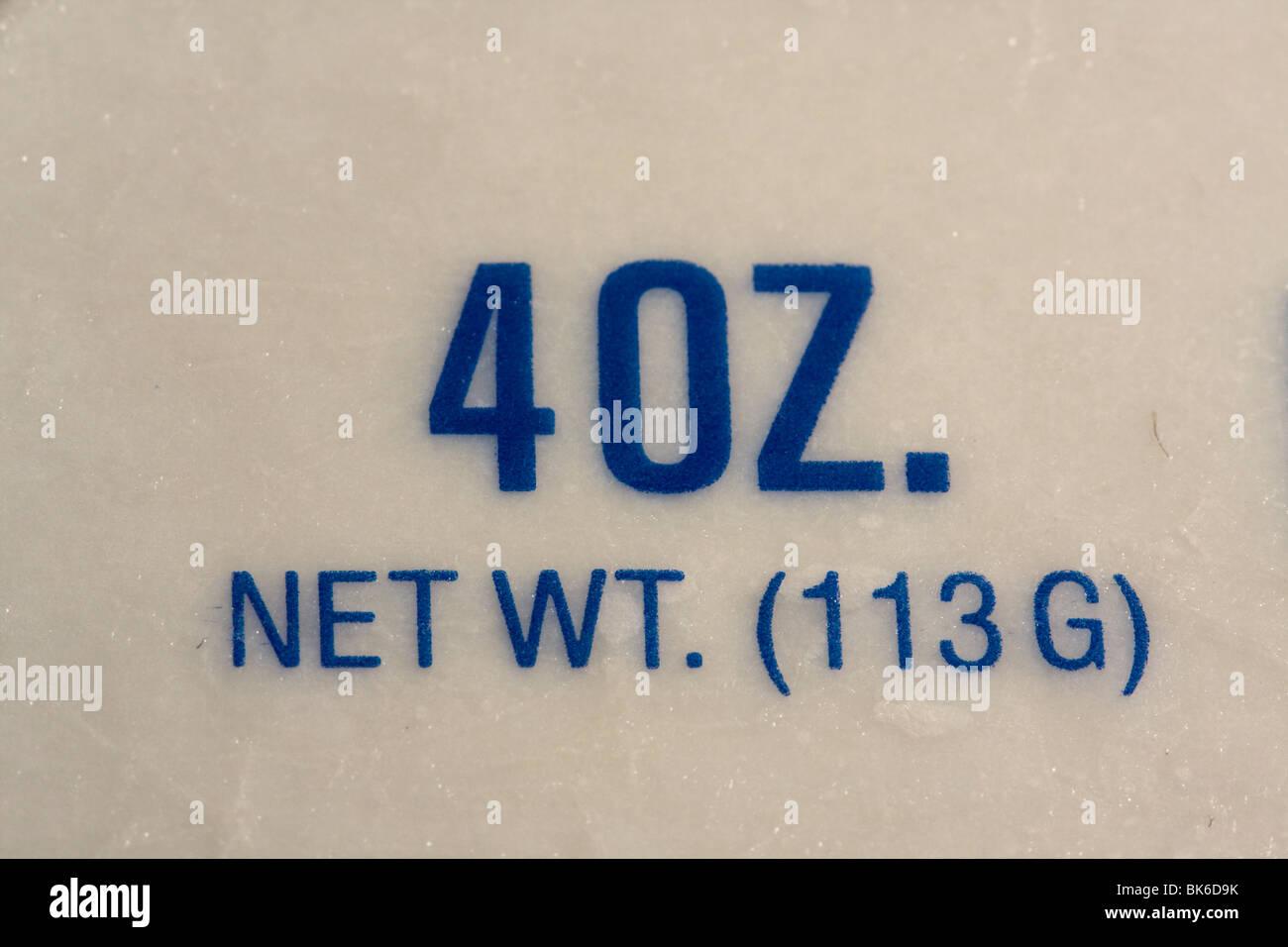 Close up 4 OZ. NET WT. (113 G) or a Quarter Pound. Stock Photo