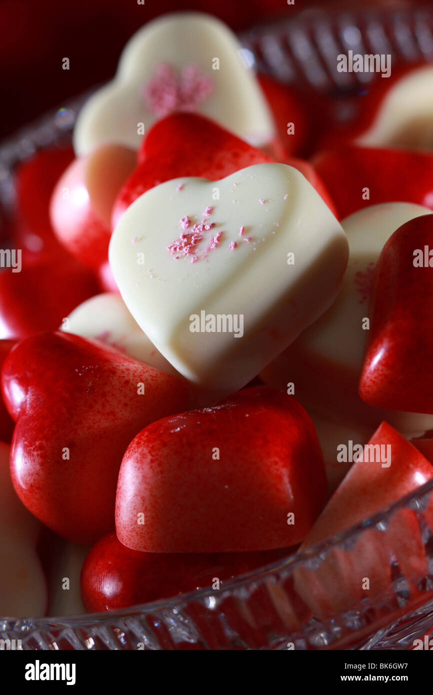 Delicious candy hearts ready to be devoured. - Stock Image