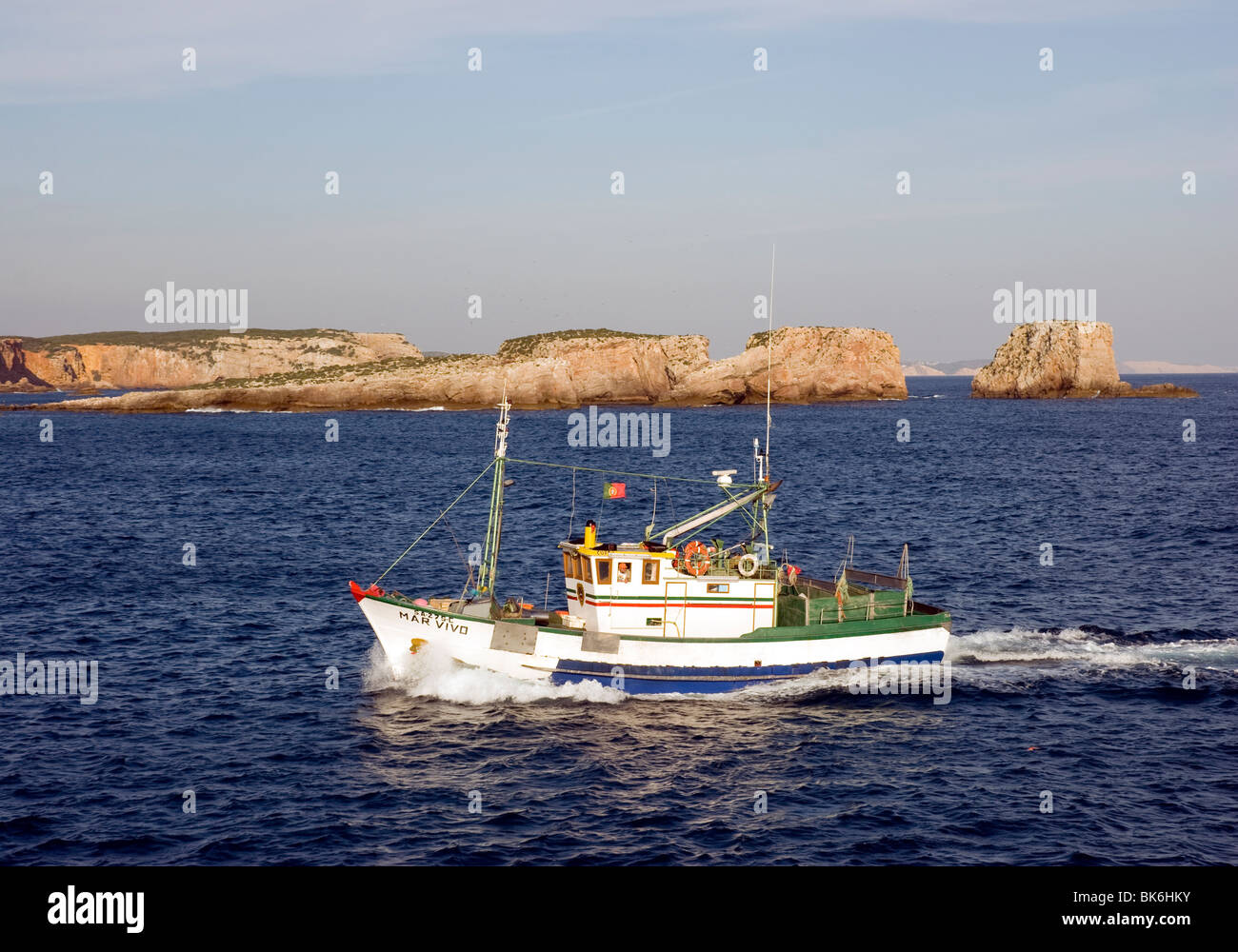 A fishing trawler in Martinhal Bay near Sagres, on southern Portugal's Algarve coast - Stock Image