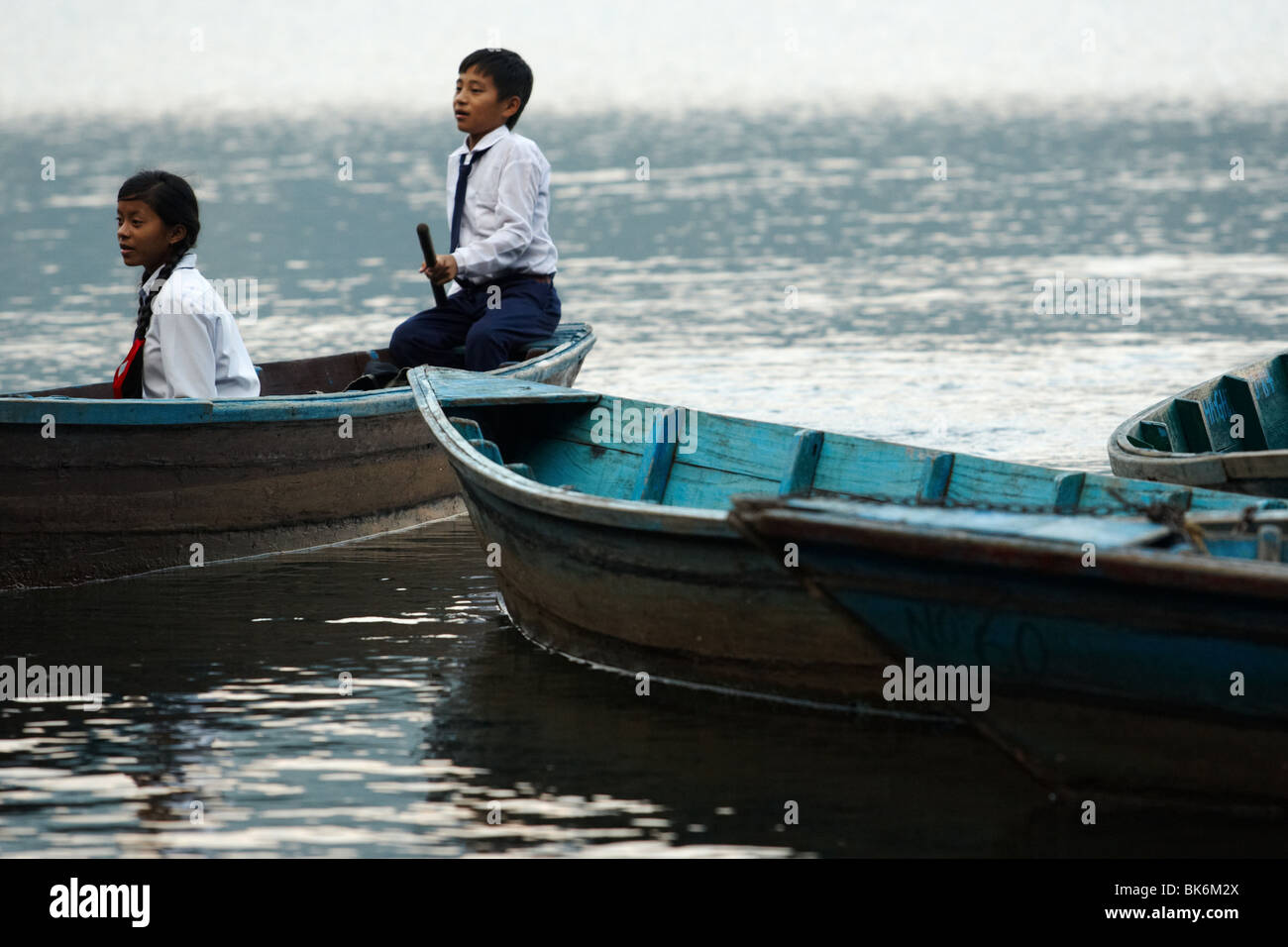 School children ride a canoe across Pewha Lake in Pokhara, Nepal on Monday October 26, 2009. - Stock Image