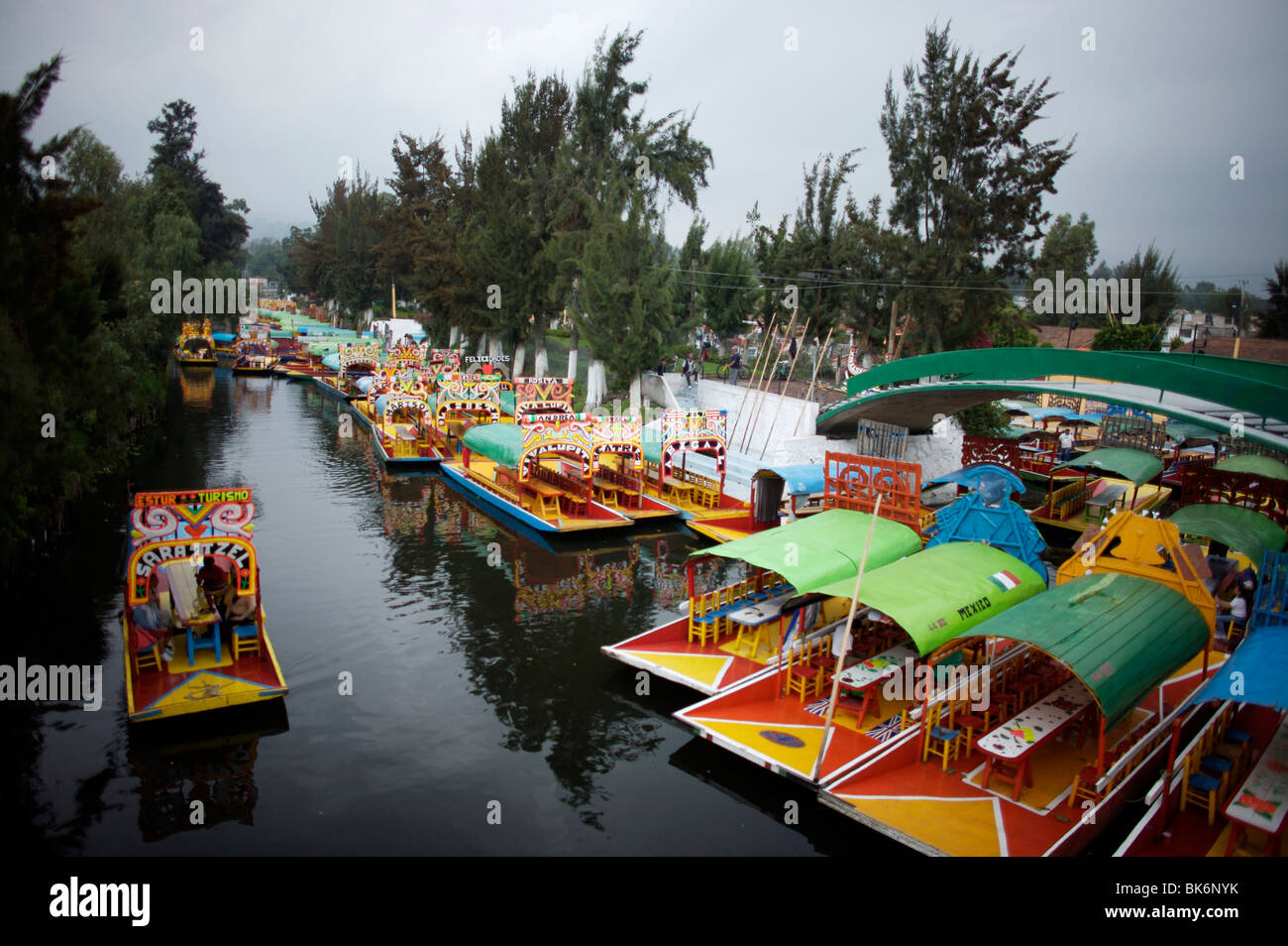 Tourists Ride In A Boat Through The Water Canals Of Xochimilco On The Stock Photo 29037783 Alamy