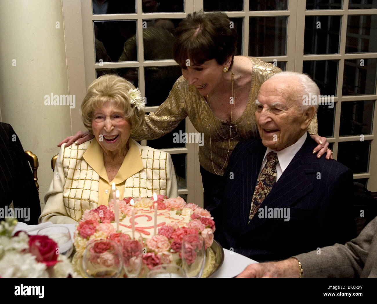 Married couple both in their late nineties celebrate their 75th wedding anniversary. - Stock Image