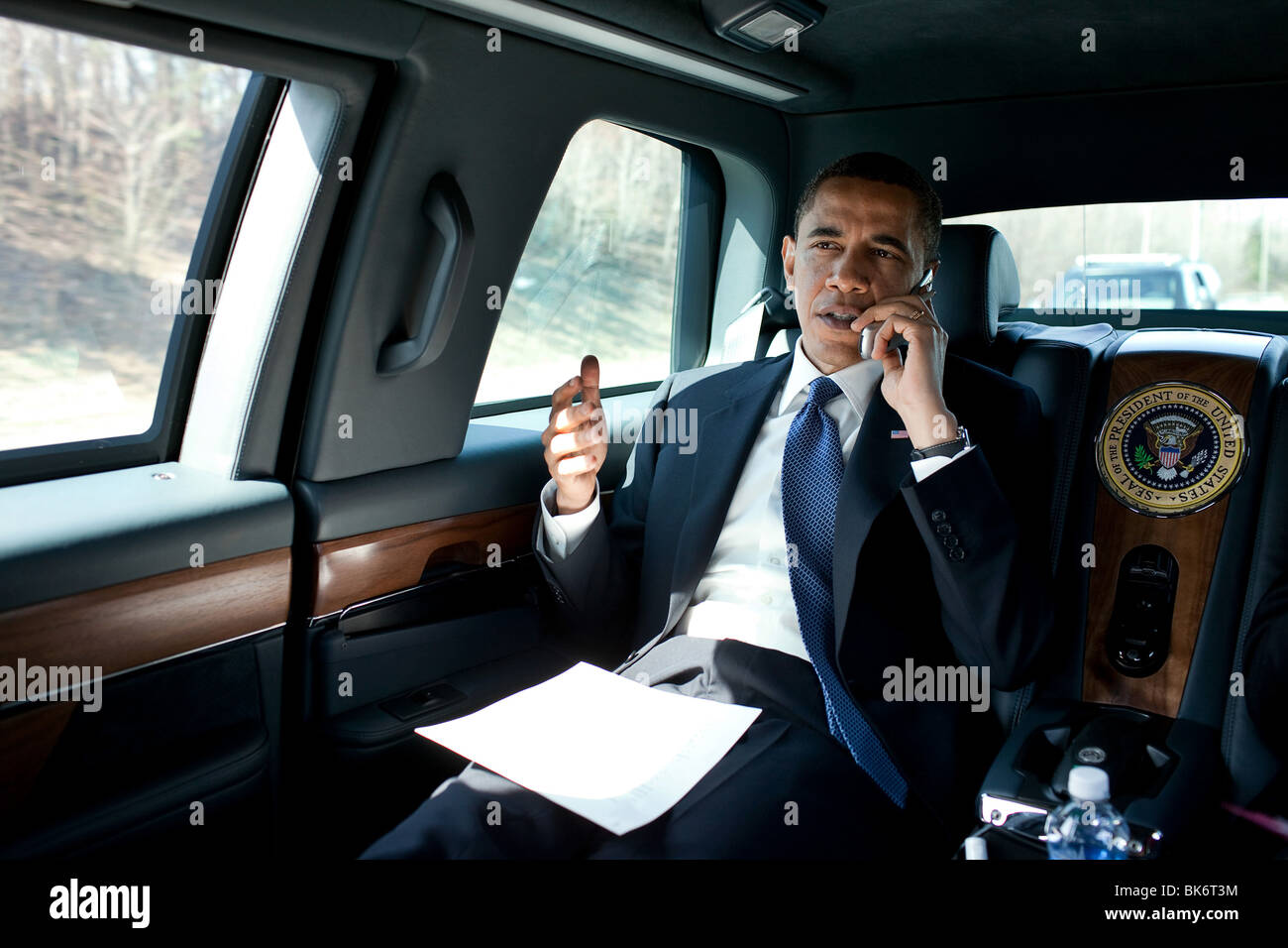 President Barack Obama talks on the phone en route to George Mason University to deliver remarks on health insurance - Stock Image