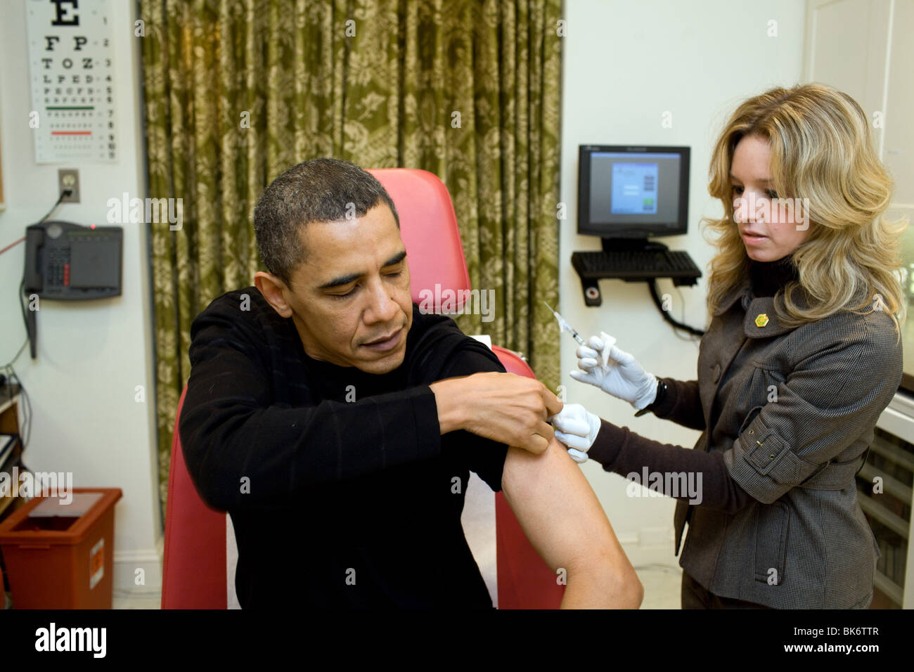 A White House nurse prepares to administer the H1N1 vaccine to President Barack Obama at the White House on Sunday - Stock Image
