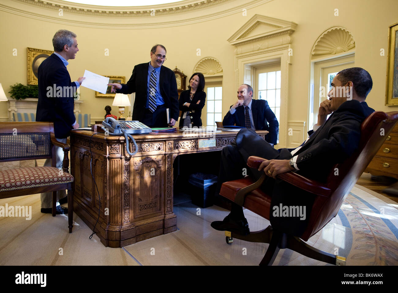President Barack Obama discusses the impending health care vote in the Oval Office - Stock Image