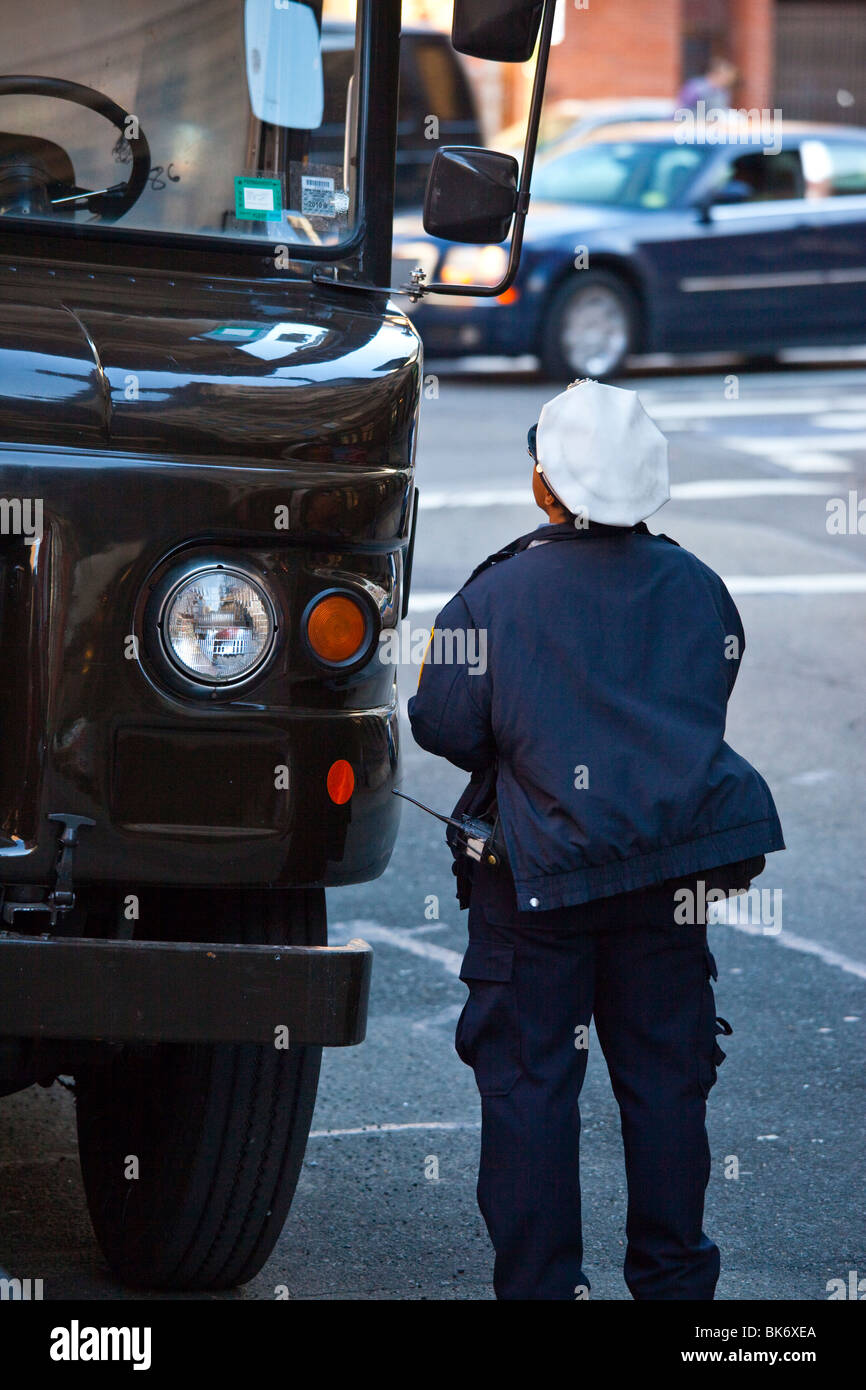 Traffic Police writing a parking ticket in Tribeca, New York - Stock Image