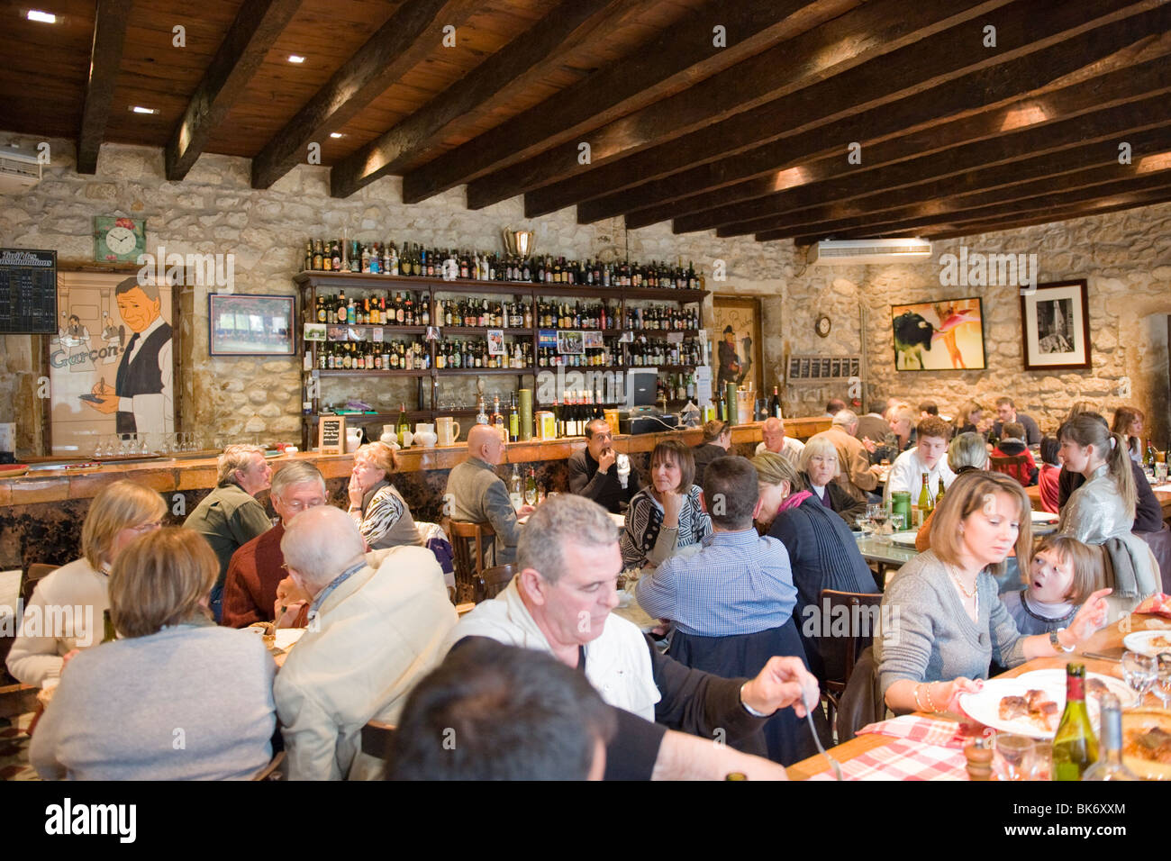 France Paradou Province Bistrot du Paradou guests diners eating restaurant of farmhouse setting wooden tables & - Stock Image