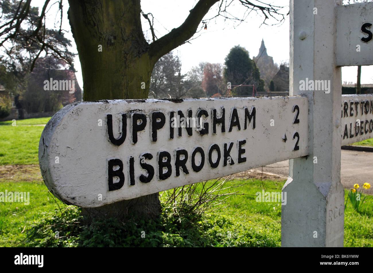 Signpost on the village green, Lyddington, Rutland, England, UK - Stock Image