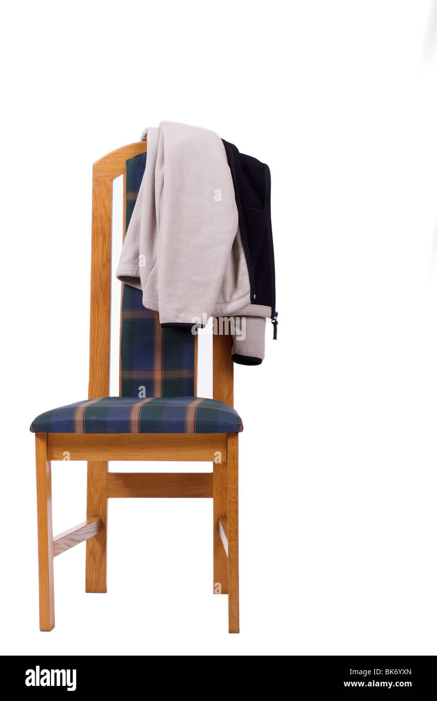 Modern High Back Chair With A Coat Draped Over The Backrest. Isolated.