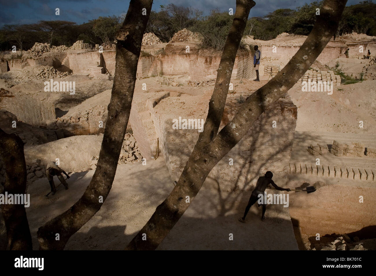 Men at work in a stone query used to make bricks to build houses on September 27, 2009 on Manda island in the Lamu - Stock Image