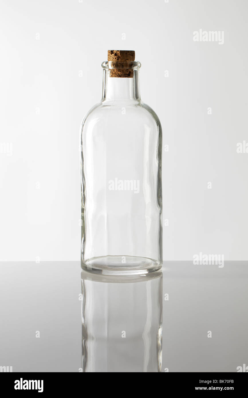 An old fashioned glass bottle with cork stopper - Stock Image