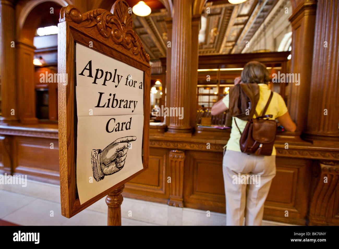 Woman applying for a Library card at the Main Branch of the New York Public Library, Manhattan, NYC - Stock Image