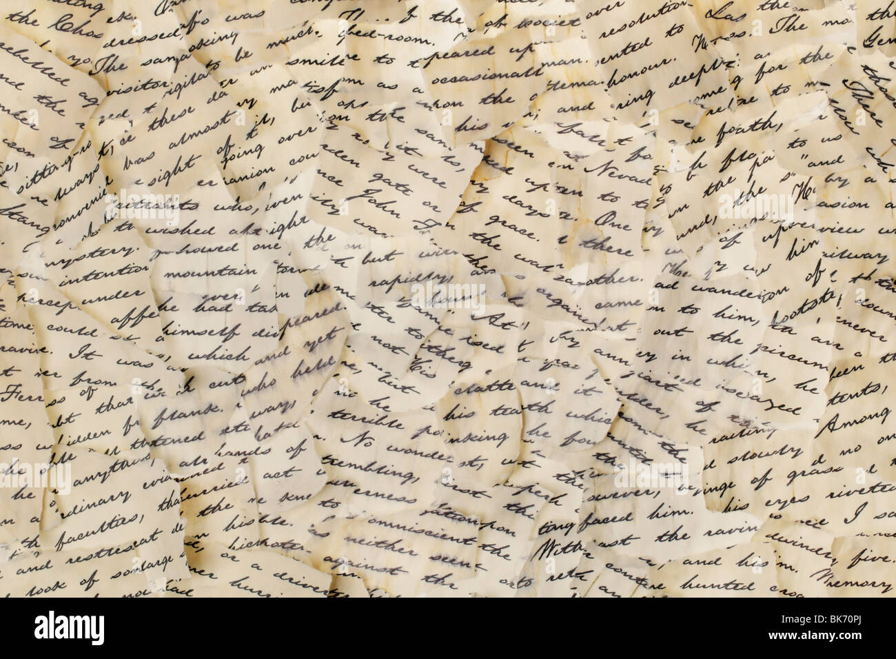 Background made of torn letters. Please note: the image may appear grainy, but that is the structure of the paper. - Stock Image