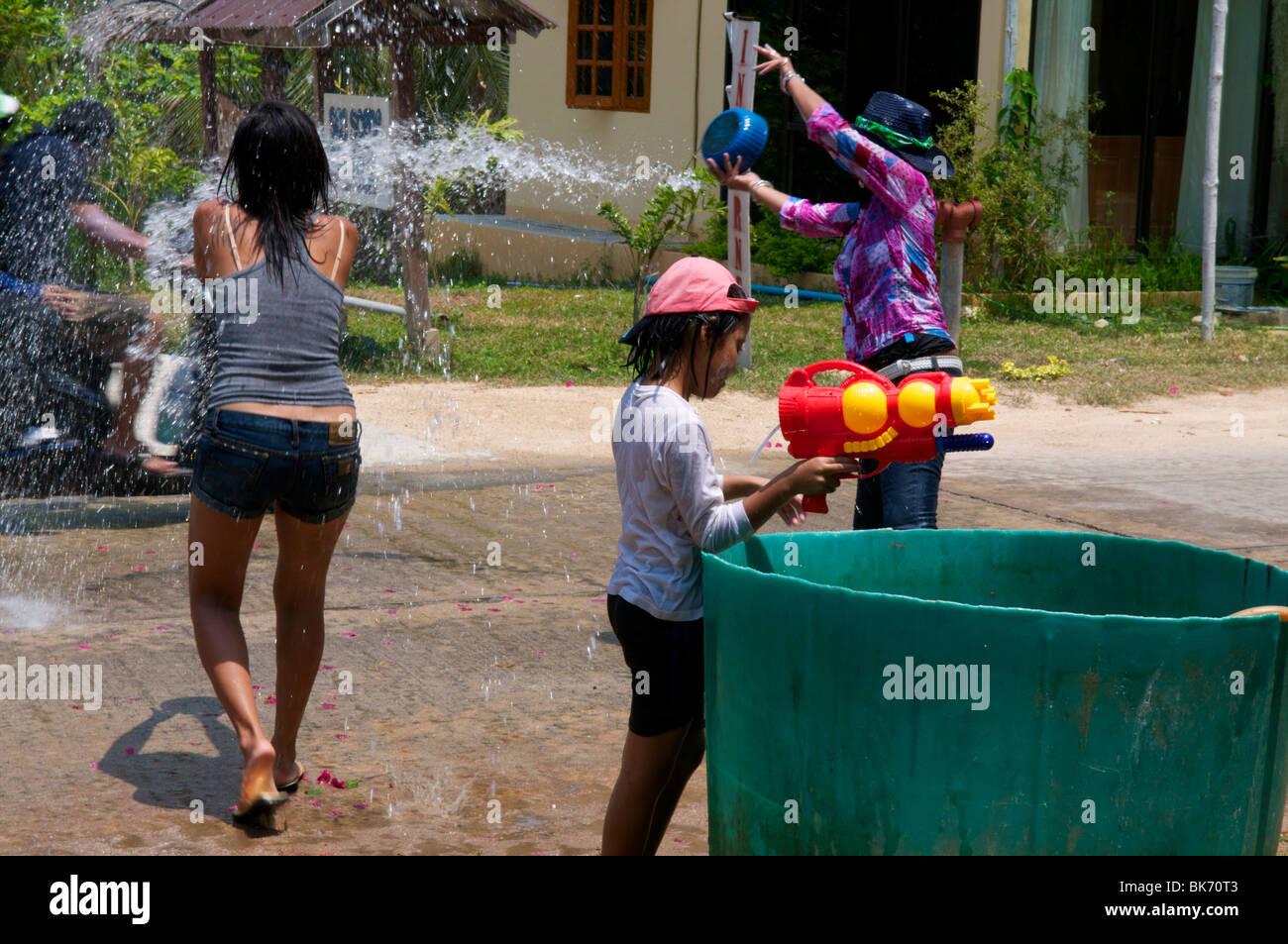 Tossing water at Songkran Festival Koh Phangan Thailand - Stock Image