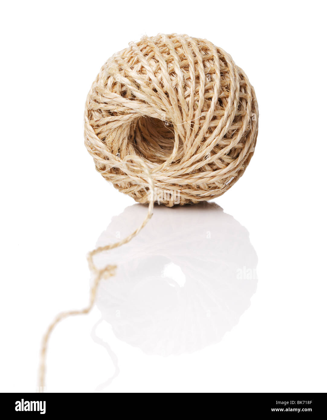 A Roll of natural fiber string on reflective background. - Stock Image