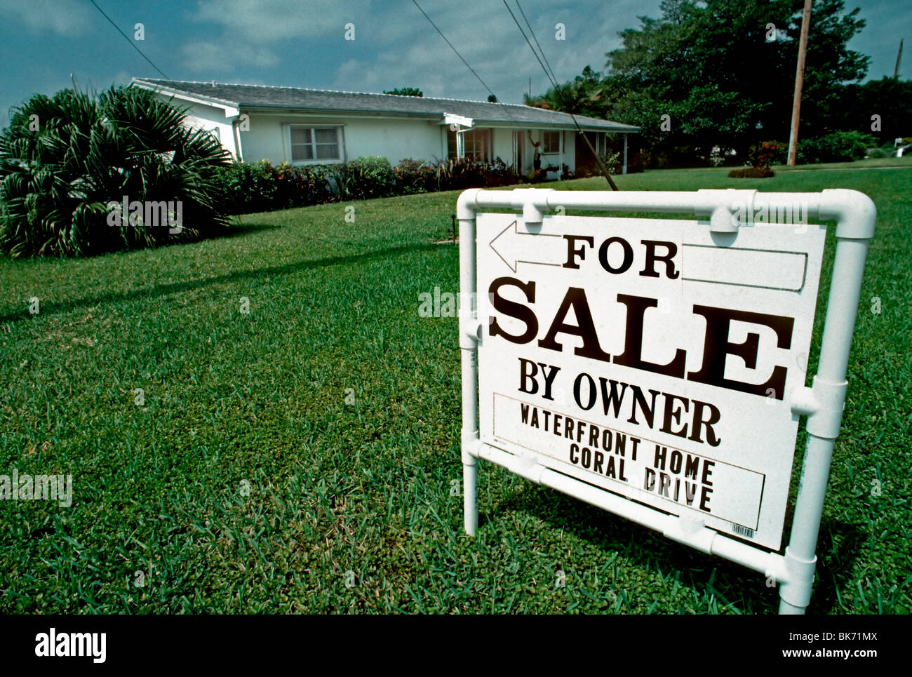 "West Palm Beach, Florida, U.S.A. - Single Family House, with ""For Sale Sign"", in Front. Stock Photo"