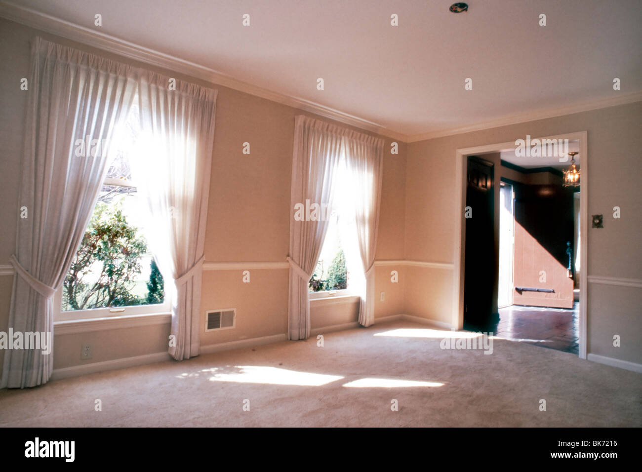 Pittsburgh, PA, Interior Showcase Home, Luxury Living Room With Two  Windows, Empty.