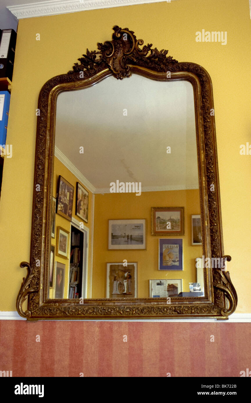 Old Baroque Style French Antique Mirror, on Wall in Living Room, Paris, France - Stock Image