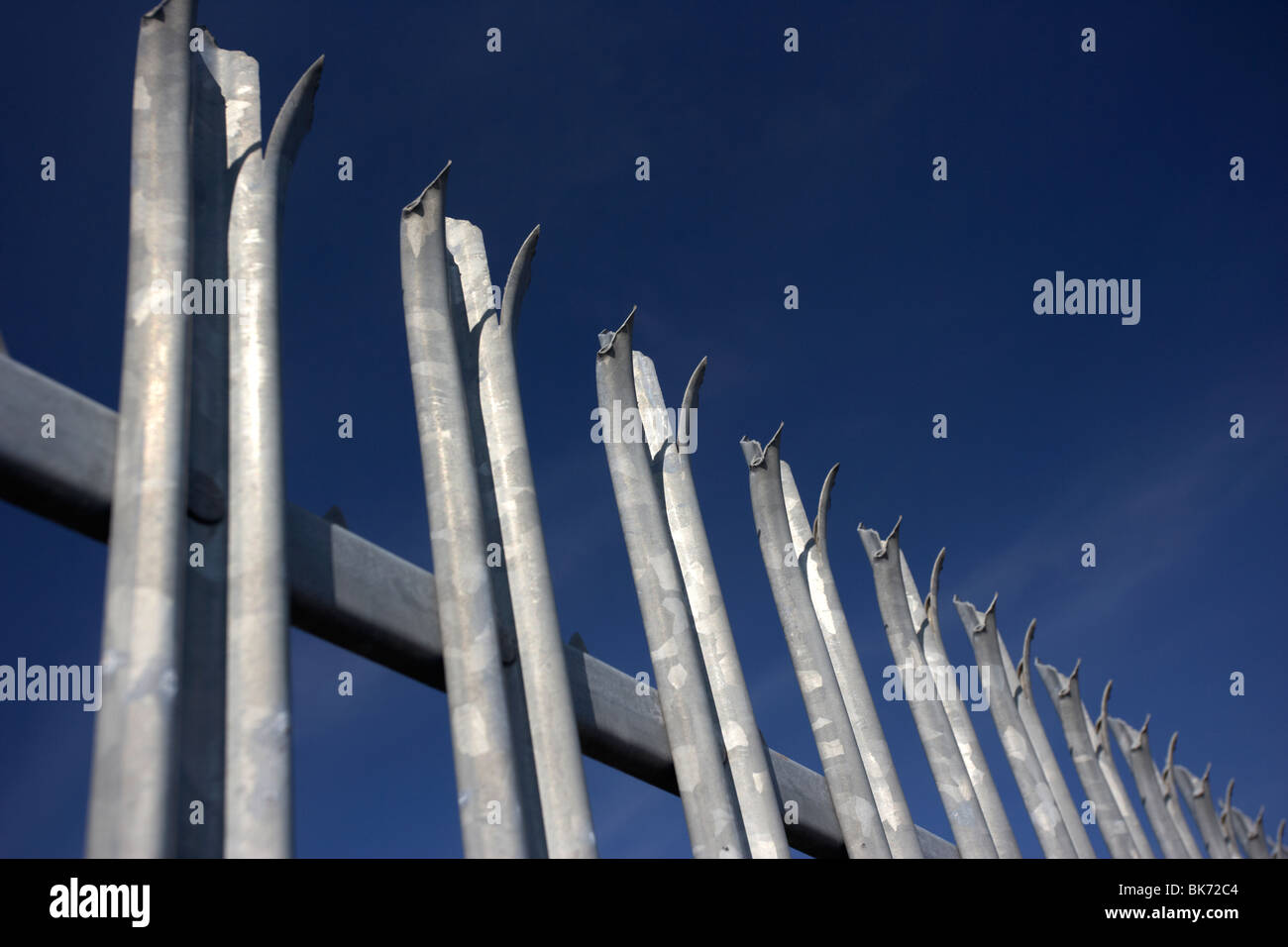 row of spikes at the top of a metal security fence in the uk - Stock Image