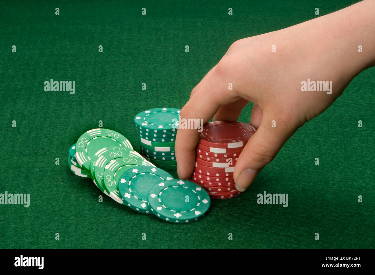 hand holding gambling chips - Stock Image