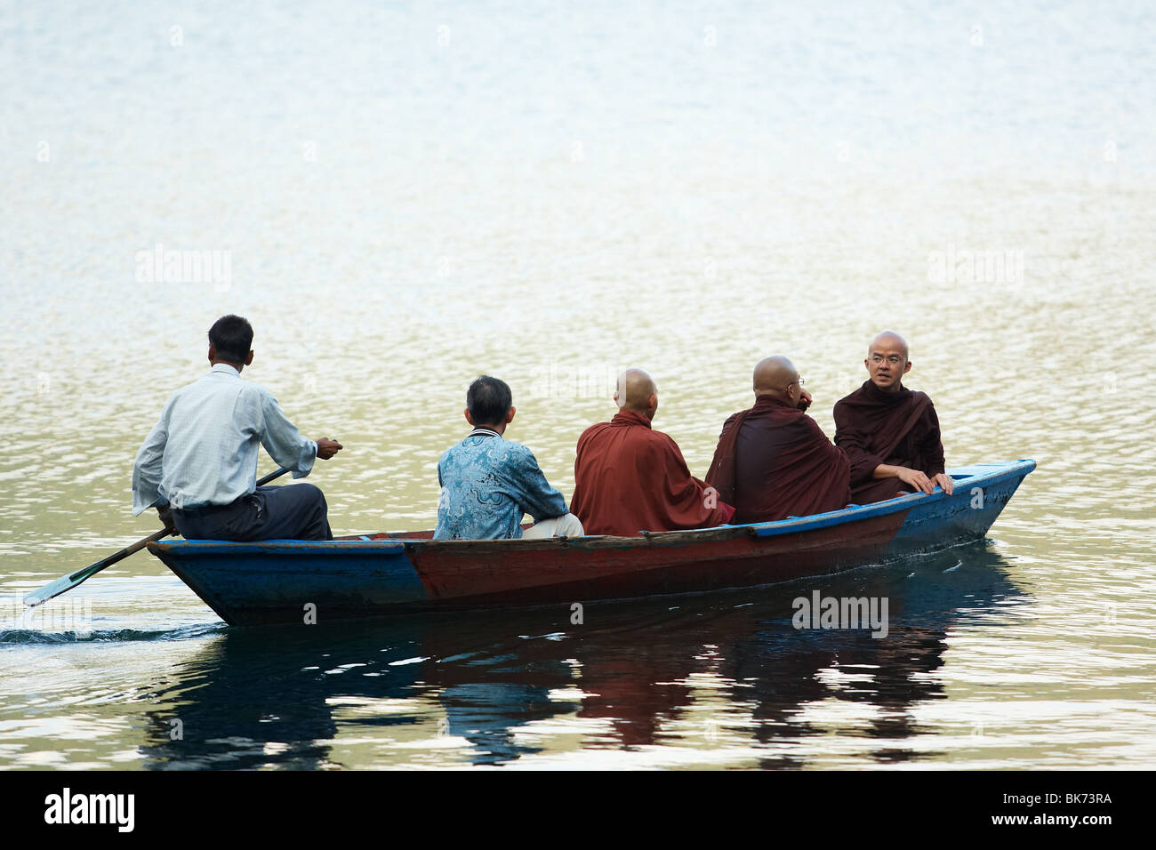 Buddhist monks in a canoe on Pewha Lake in Pokhara, Nepal on Monday October 26, 2009. - Stock Image
