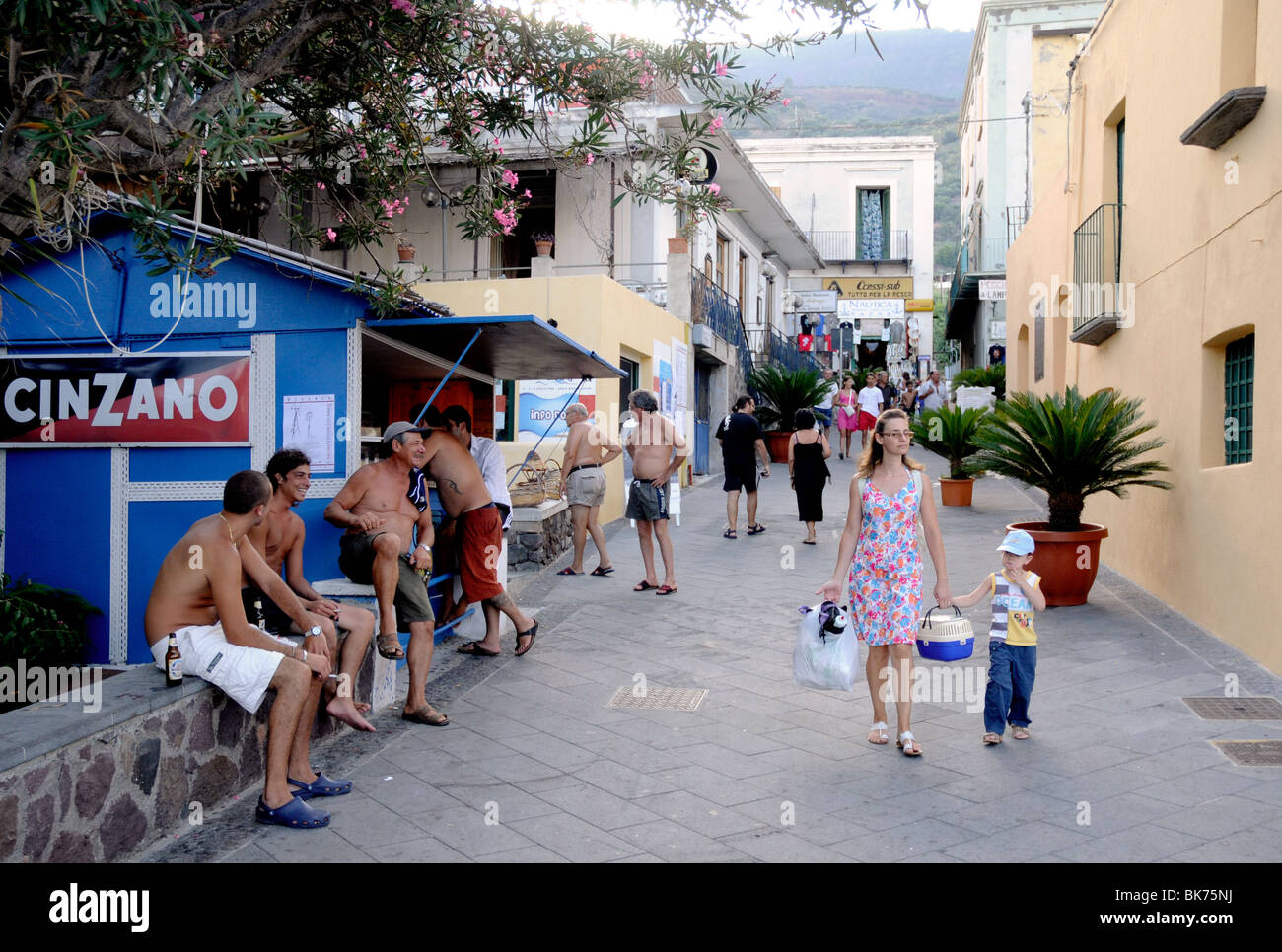 People milling about the port area of Santa Marina, on the Aeolian Island of Salina. - Stock Image