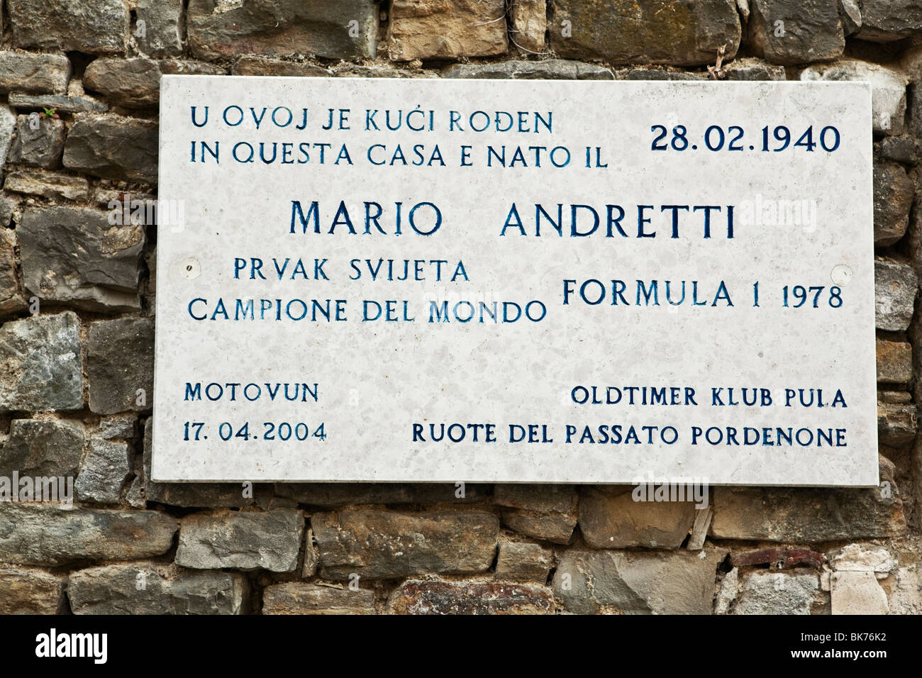 Placard showing birthplace of legendary formula 1racing car driver Mario Andretti in Motovun Istria Croatia - Stock Image