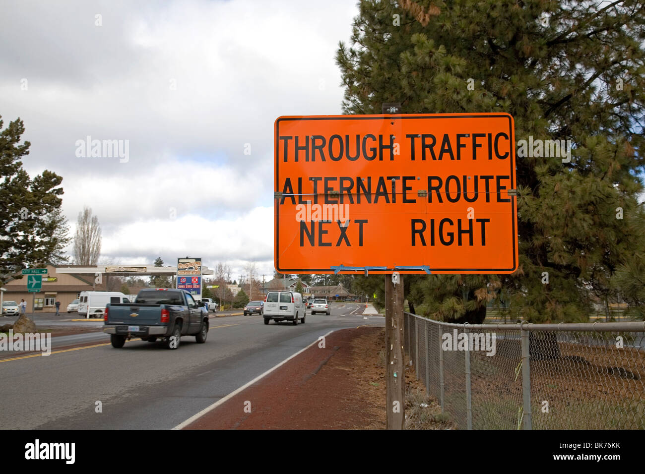 A traffic detour sign at a highway road construction site - Stock Image