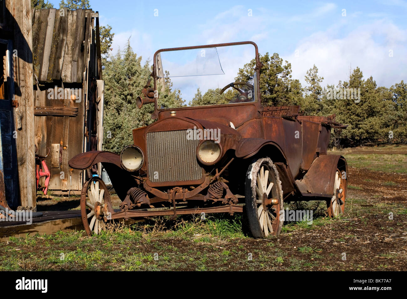 A rusted old classic antique automobile from the 1920s - Stock Image